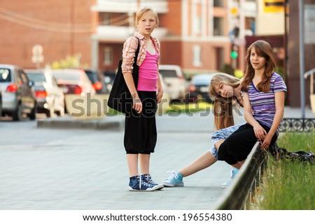 Group of school girls on the city street - stock photo