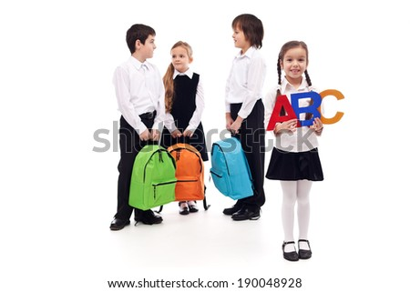 Group of school kids with colorful bags - isolated - stock photo