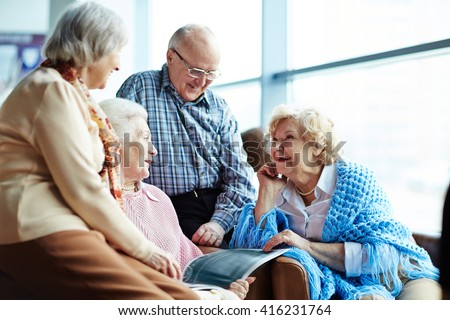 Group of senior friends chatting - stock photo
