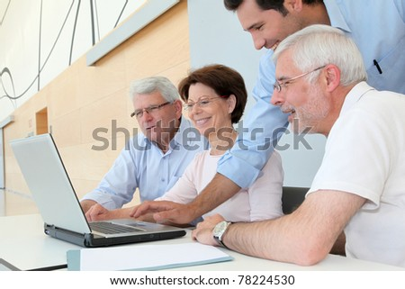 Group of senior people attending job search meeting - stock photo