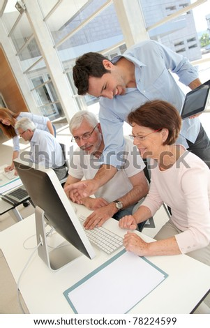 Group of senior people in business training - stock photo