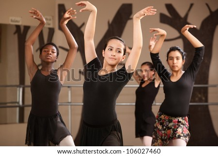 Group of serious ballet dance students performing - stock photo