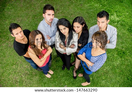 Group of serious hispanic young people - stock photo