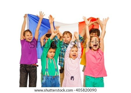Group of seven kids smiling and waving French flag