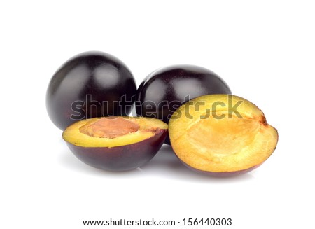 Group of shiny ripe plums isolated on white