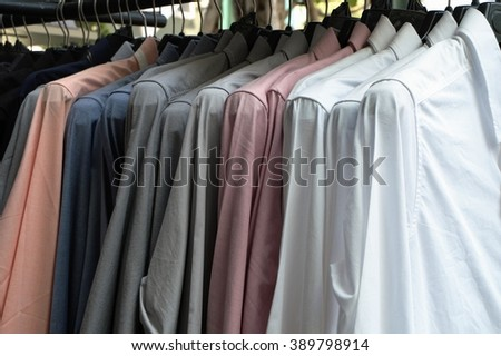Group of shirts on a hanger - stock photo