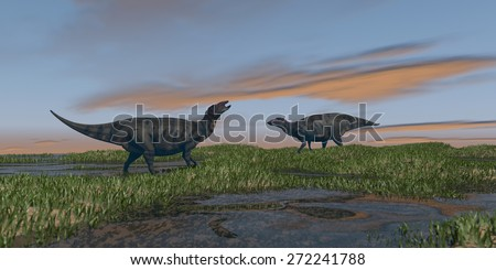group of shuangmiaosauruses grazinf in grass field - stock photo