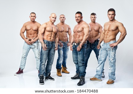 Group of six muscular young sexy wet naked handsome man posing  - stock photo