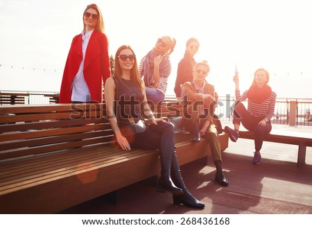 Group of six smiling women posing together for vacation photo at sunny day, vacation travel holidays wit best friends, group of attractive women having fun spending time together - stock photo