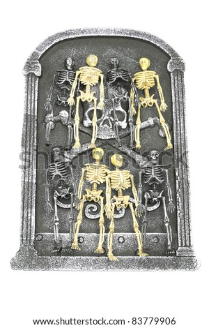 Group of skeletons waiting on a head stone for Halloween or Cinco De  Mayo isolated on white - stock photo