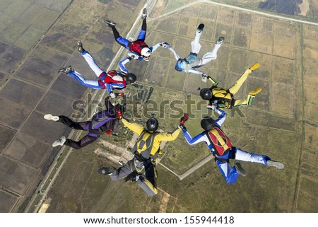 Group of skydivers in freefall.