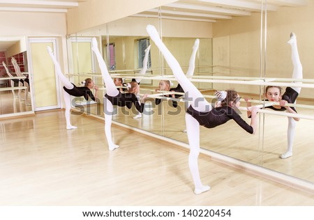 group of small dancers in a training hall - stock photo