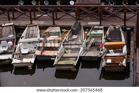 Group of small row boats beached on the port in river Moldau in Prague - stock photo