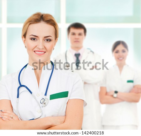 Group of smart and confident hospital workers - stock photo