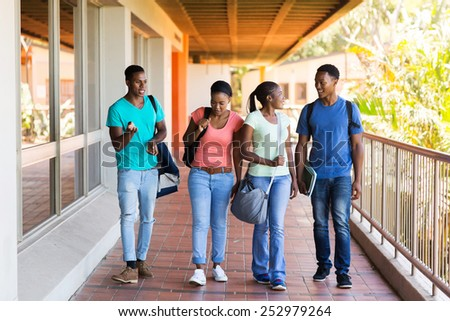 group of smart college students walking to lecture hall - stock photo
