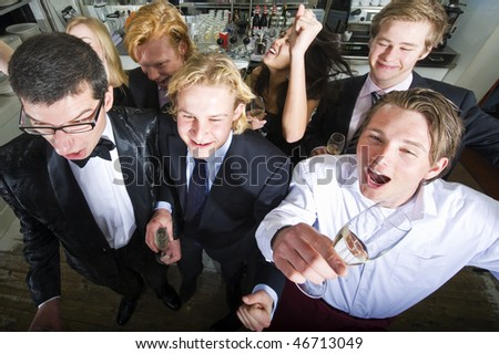 Group of smartly dressed people celebrating an event in a bar - stock photo
