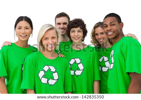 Group of smiling activists wearing green shirt with recycling symbol on it on white background - stock photo