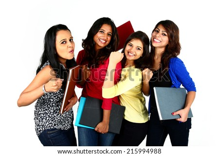 Group of smiling Asian female friends/students, isolated on white background - stock photo