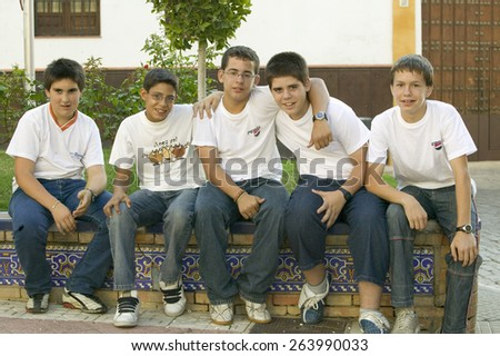 Group of smiling boys in village of Southern Spain off highway A49 west of Sevilla