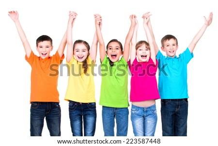 Group of smiling children with raised hands in colorful t-shirts standing together - isolated on white. - stock photo