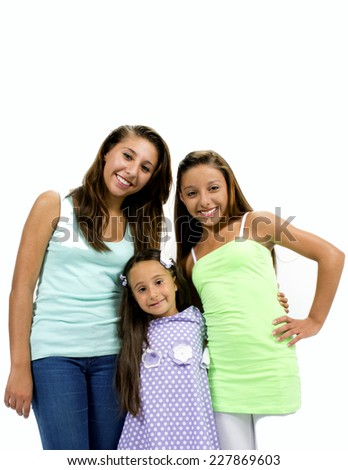 Group of smiling girls posing in front of the camera