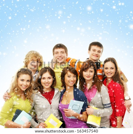 Group of smiling happy teenagers over Christmas background - stock photo