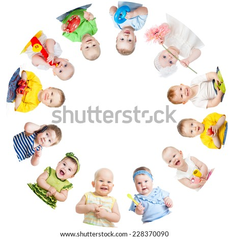 Group of smiling kids standing in huddle isolated on white background - stock photo
