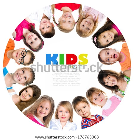 Group of smiling kids standing in huddle on white background - stock photo