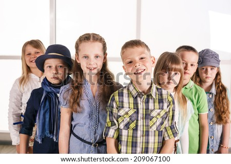Group of smiling kids standing together