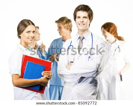 Group of smiling medical on white background - stock photo