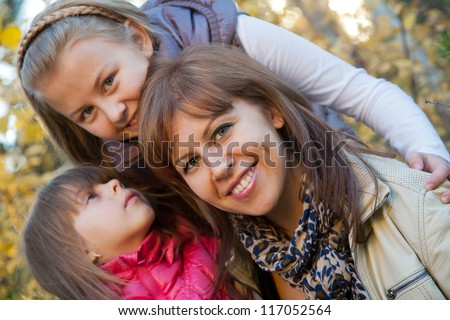 Group of smiling mother and two girls - stock photo