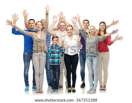 group of smiling people waving hands