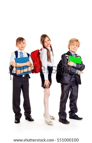 Group of smiling schoolchildren standing together and holding books. Isolated over white. - stock photo