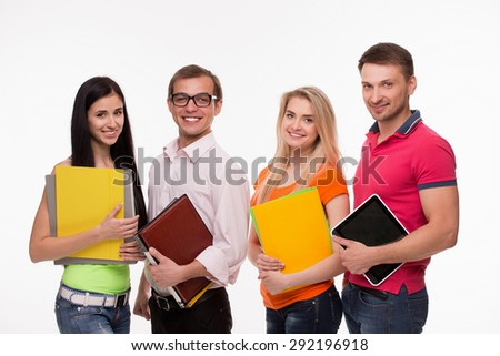 Group of smiling students going to lectures of physics. Adult student keeping documents in their hands. - stock photo