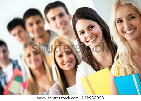 Group of smiling students posing. - stock photo