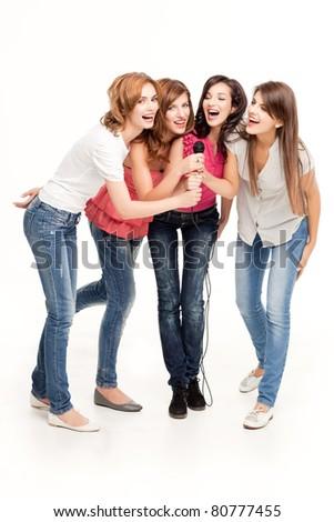 group of smiling women having fun singing - stock photo
