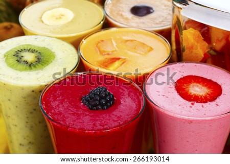 Group of smoothies with fresh fruit - stock photo