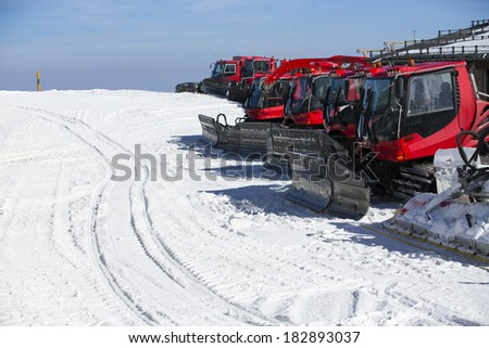 Group of Snow-grooming machine on snow hill ready for skiing slope preparations in Sierra Nevada, Granada.