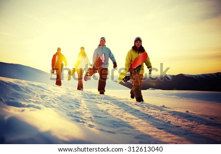 Group of Snowboarders on Top of the Mountain Concept - stock photo