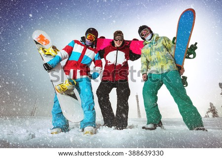 Group of snowboarders posing on the top of the mountain. Sheregesh resort, Siberia, Russia - stock photo