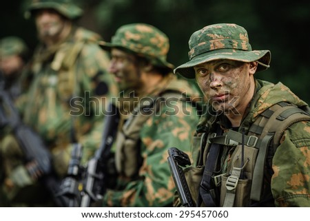 Group of soldiers Russian special forces during the raid in the forest - stock photo