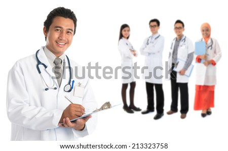 Group of southeast Asian doctors standing isolated on white background. - stock photo