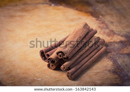 Group of spaces with cinnamon on wooden background. Selective focus.