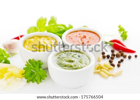 Group of spicy sauces with ingredients - stock photo