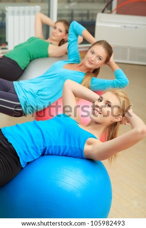 Group of sportive young women in the gym centre.