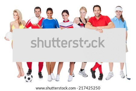 Group of sports people presenting empty banner. Isolated on white - stock photo