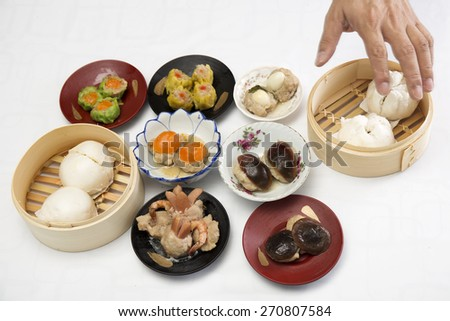 Group of stream Dim Sum chinese food / Cooking Dim sum concept - stock photo
