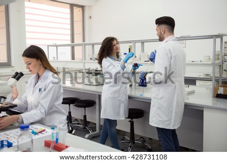 group of students carried experiment - stock photo