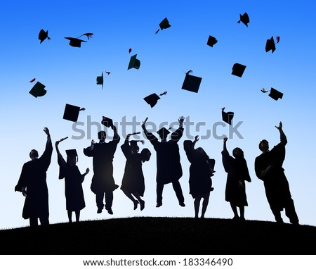 Group Of Students Celebrating Graduation and Throwing Caps - stock photo