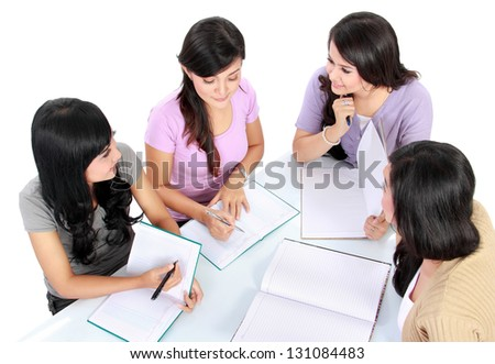 group of students having discussion making homework